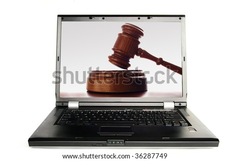 Laptop a judges court gavel on screen, over white - stock photo