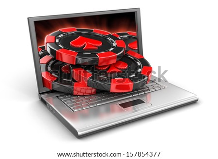 Laptop and Casino chips (clipping path included) - stock photo