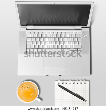 laptop and cup of coffee on table, view from above - stock photo
