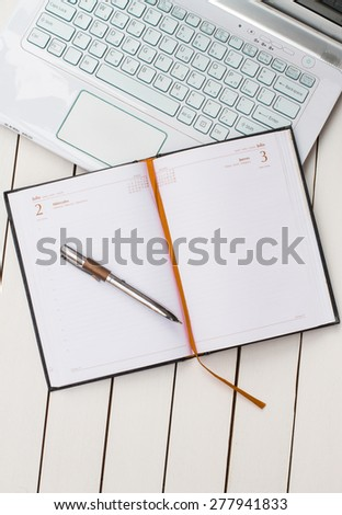 laptop and diary - stock photo