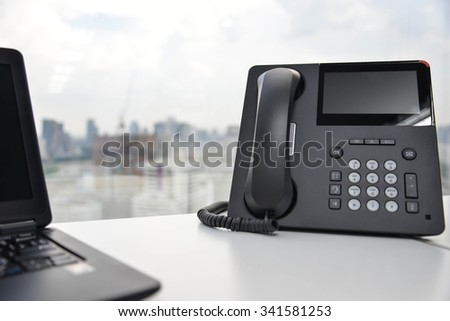 Laptop and IP Phone - stock photo