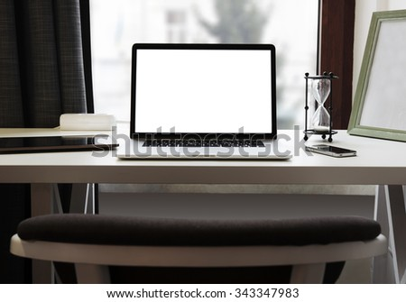 Laptop and other electronics  on workspace - stock photo
