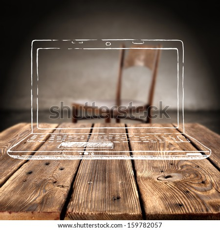 laptop and wooden table  - stock photo