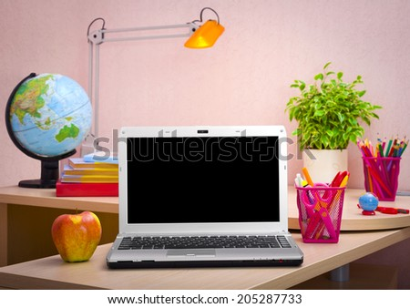 Laptop, books and school supplies. Education concept - stock photo
