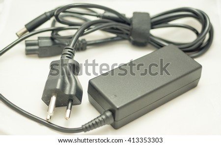 Laptop charger power adapter - stock photo