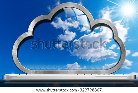 Laptop Computer - Cloud Computing / Laptop computer with a screen in the shape of a cloud with a blue sky and clouds. Concept of cloud computing - stock photo