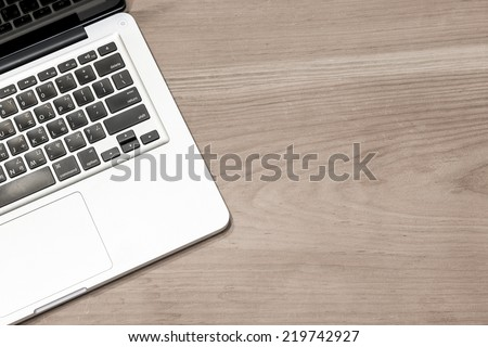 Laptop computer on a wooden desk. Top view. great for your copy space - stock photo