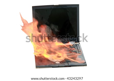 laptop computer on fire, represents computer damage, loss of data, emergency and more, isolated on white - stock photo