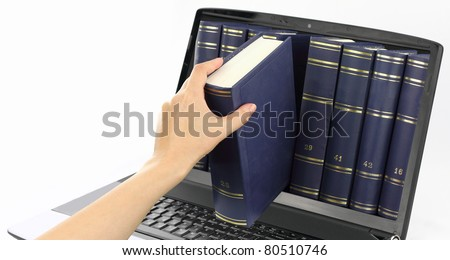 Laptop computer with books, isolated on white - stock photo