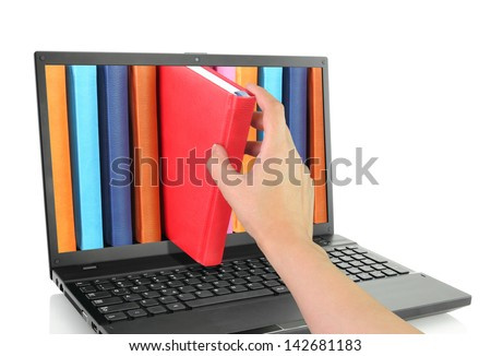 Laptop computer with colored books - stock photo
