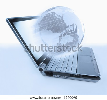 Laptop computer with globe emerging from the screen - stock photo
