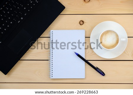 Laptop, empty notebook, pen, cup of coffee - business concept   - stock photo