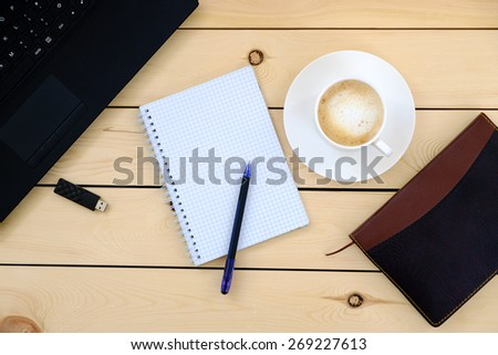 Laptop, empty notebook, pen, diary, cup of coffee - business concept   - stock photo