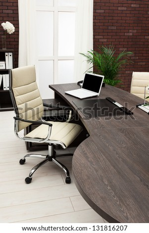 laptop on a desk in a modern office - stock photo