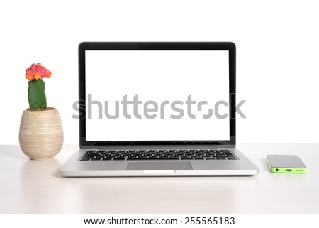 Laptop on a light table with a telephone - stock photo