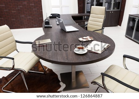 laptop on a table in a modern office - stock photo