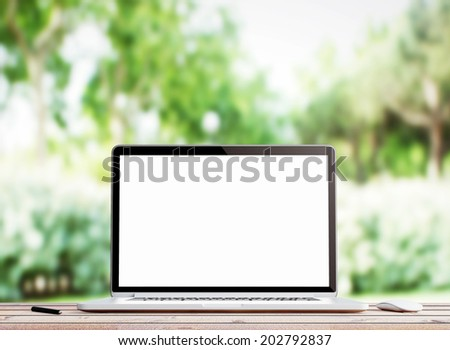 Laptop on nature - stock photo