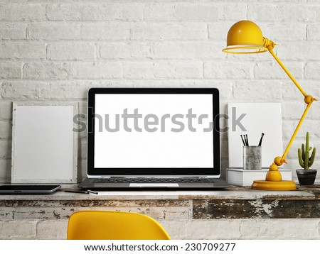 Laptop on table, White brick wall background - stock photo