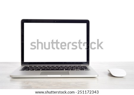 Laptop on wooden table notebook and mouse - stock photo