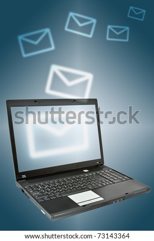 Laptop over dark background. Communication concept. - stock photo
