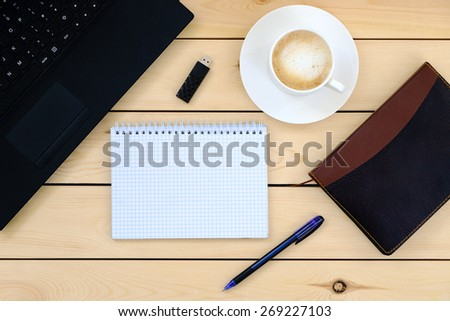 Laptop, tablet, diary, cup of coffee - business concept   - stock photo