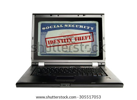 Laptop with a Social Security card and Identity Theft text in red - stock photo