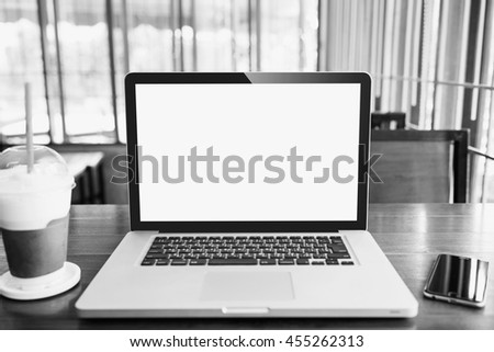 Laptop with blank screen on table.  laptop white screen.  - stock photo