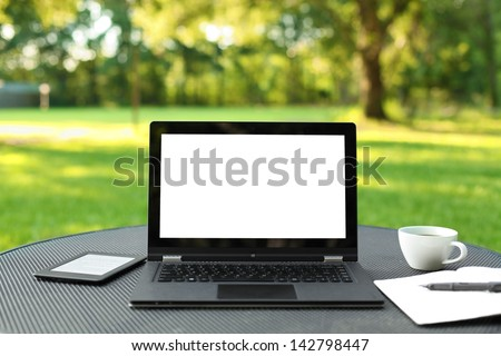 Laptop with blank screen outdoors - stock photo