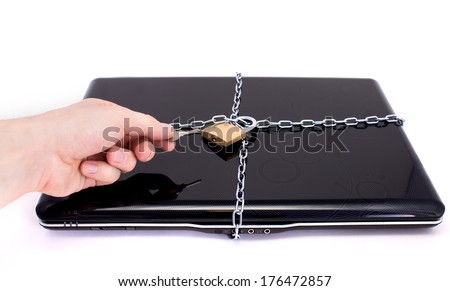 Laptop with chains and padlock. Concept for computer security - stock photo