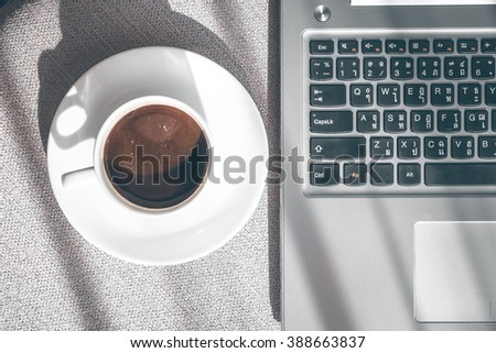 Laptop with coffee cup home office. - stock photo