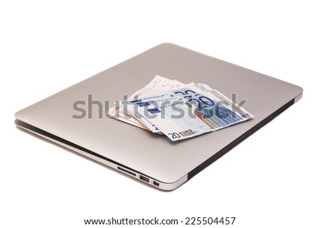Laptop With Dollars And Euro money - stock photo