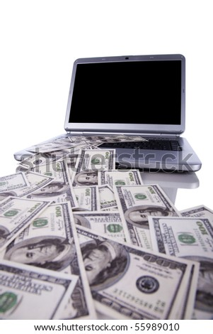 Laptop with lots od money, spending or making money concept (with copy space) - stock photo