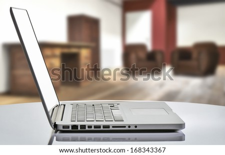 laptop with man hand in loft studio - stock photo