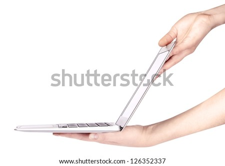 laptop with woman hand isolated on a white background - stock photo