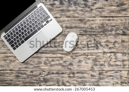 Laptop. Working table overhead view, wooden table in vintage tone. - stock photo