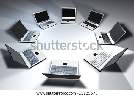 Laptops in a circle with white light - stock photo