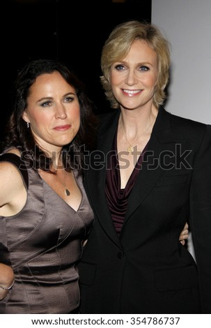 Lara Embry and Jane Lynch at the 22nd Annual Producers Guild Awards held at the Beverly Hilton hotel in Beverly Hills, California, United States on January 22, 2010.  - stock photo