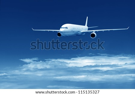 Large aircraft is going for landing. Against cloudy sky. - stock photo