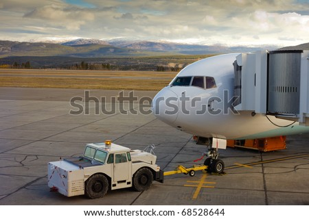 Large airliner ready for boarding on Whitehorse international airport, Yukon Territory, Canada - stock photo