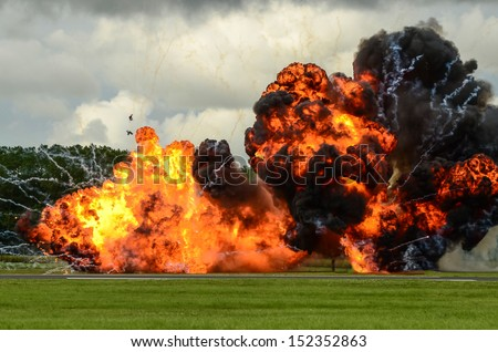 large, and frightening explosion photographed at an airshow display, involving 2 RAF Tornado jet fighter bombers. - stock photo