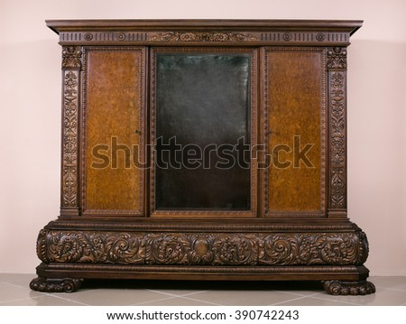 large antique carved cupboard - stock photo