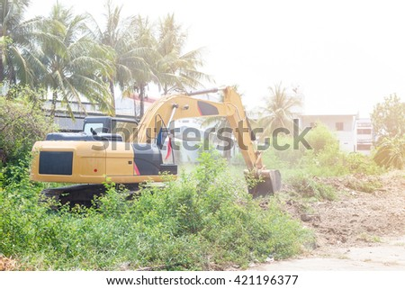 Large backhoe loader heavy dig soil stone. - stock photo