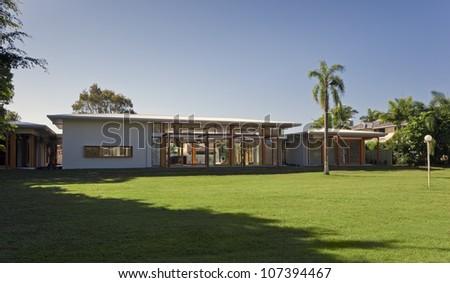 Large backyard in stylish Australian mansion - stock photo