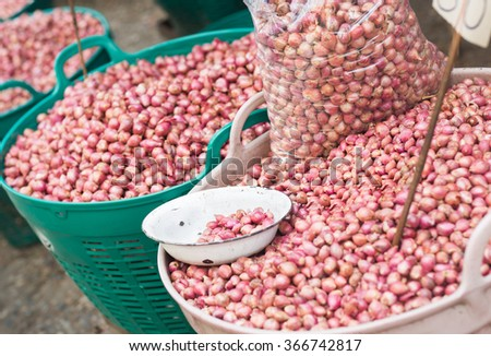 Large baskets of many purple onions at the farmers market. - stock photo