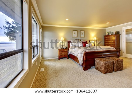 Large bedroom with water view. - stock photo