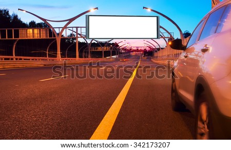 large billboard on the night highway - stock photo