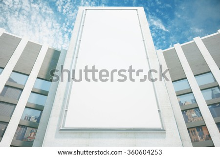 Large billboard on the wall of a building on a sky background - stock photo