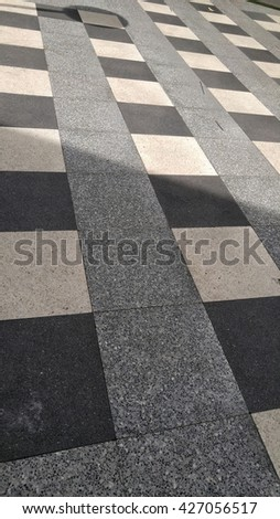large black and white checker floor background pattern - stock photo