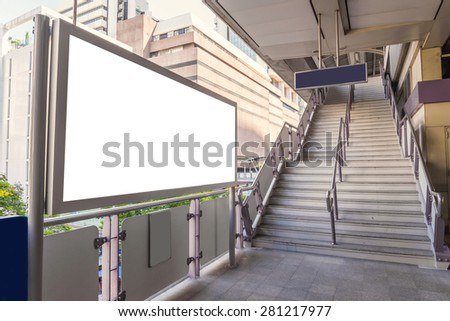 large blank billboard on overpass with city view background. - stock photo