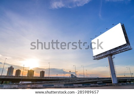 large blank billboard with city view and background. - stock photo